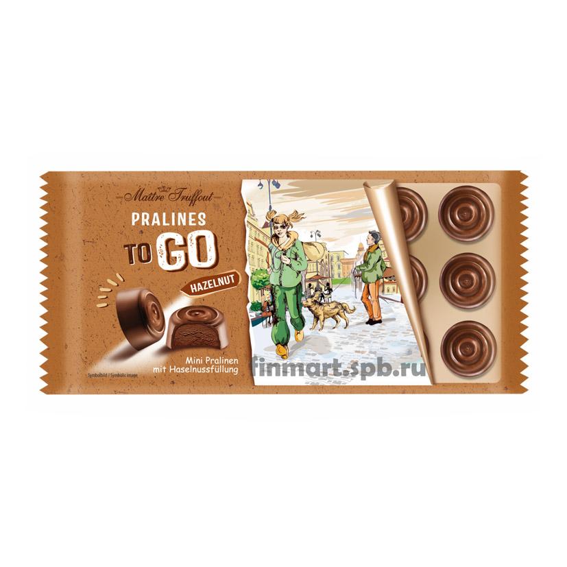 конфеты из молочногошоколада наполненные пралине из лесного ореха Maitre Truffout Pralines to GO huzelnut - 100 гр.