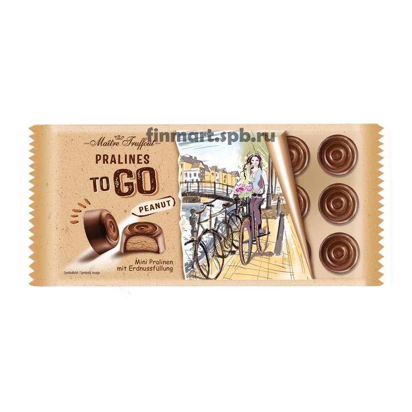 Конфеты из молочногошоколада наполненные арахисовым пралине Maitre Truffout Pralines to GO peanut - 100 гр.